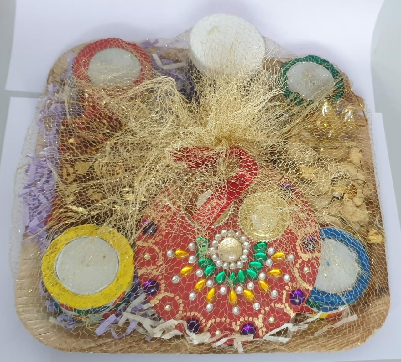 Diwali Hamper (Kumkum Chokha Plate, 4 Diyas, Roasted Almond, Roasted Cashew, Raisins, Honey) Slider Thumbnail 1/5