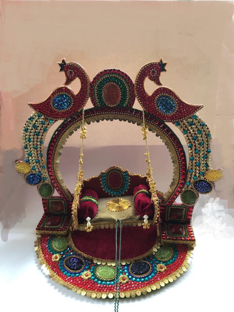 Peacock adorned Swing (Jhula) for Janmashtami Slider Thumbnail 1/2